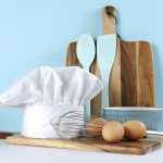 Modern kitchen cooking kitchenware and chef's hat with mixing bo
